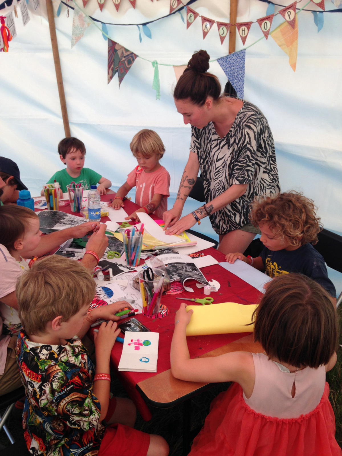 Harriet making zines with children at Forgotten Fields Festival
